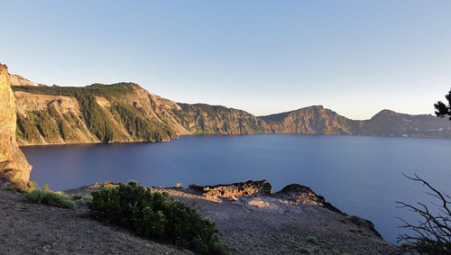 Crater Lake from the Phantom Ship Overlook, near sunset. 7,700 years ago, Mount Mazama emptied its magma chamber in a humongous eruption (that's an official scientific classification), and collapsed into itself, leaving a hole in its heart that filled with a lake that is the bluest blue you've ever seen.
