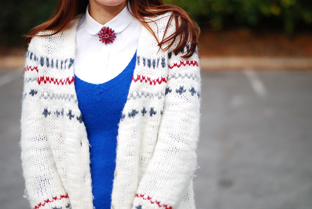 Knitted Layers With a Peter Pan Collar and Brooch