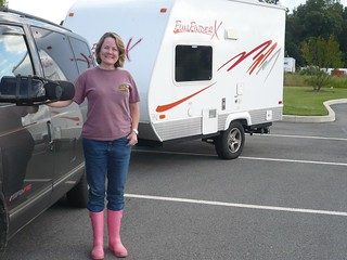 Teri Fahrendorf, president of the Pink Boots Society, stands in front of her truck and trailer wearing pink boots