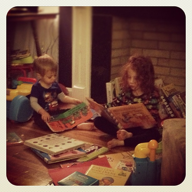 Pictured:  why I can't wait for them to get the kindle for Xmas. THERE ARE BOOKS EVERYWHERE ALL THE TIME.