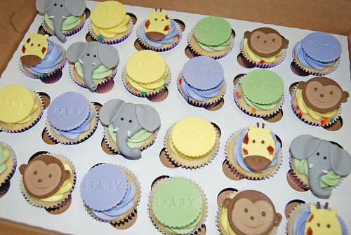 purple yellow and green jungle animal baby shower cupcakes