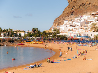 Image of Playa Mogan. ocean trip family sea vacation sky holiday mountains slr beach water grancanaria outdoors island spain sand rocks olympus event abroad digitalcamera e3 zuiko digitalslr mogán zuikodigital 1260mm olympuse3