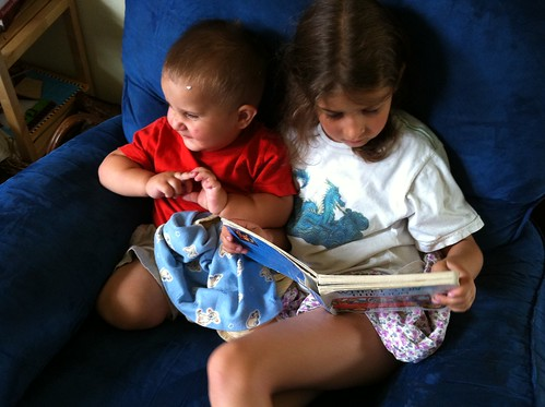 Bella reads to Anthony
