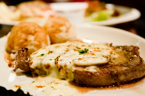 Santa fe Steak's Porkchop with cheese on top served with mashed potatoes