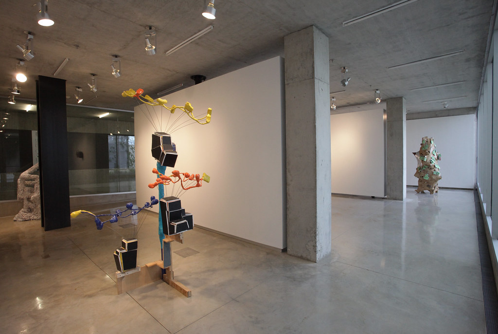 A view of the exhibition in Mistein Gallery. In the foreground, left, is <em>Hollywood Hills</em> (2009), wood, tape, vinyl, dry wall, metal, and plastic.