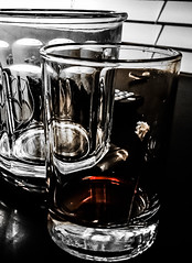 wine glass(0.0), stemware(0.0), monochrome photography(0.0), monochrome(0.0), black-and-white(0.0), lighting(0.0), old fashioned glass(1.0), whisky(1.0), drinkware(1.0), distilled beverage(1.0), glass(1.0), still life photography(1.0), drink(1.0), pint (us)(1.0), alcoholic beverage(1.0),