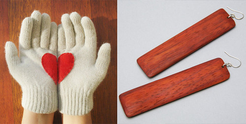 A pair of cream gloves with red stitched heart on wood grain background and a pair of wood earrings on gray background.