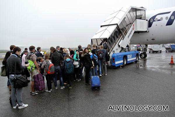Boarding a smaller Finnair plane to Switzerland