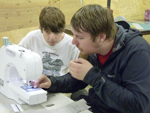 Ben and Ian sewing a sword cover