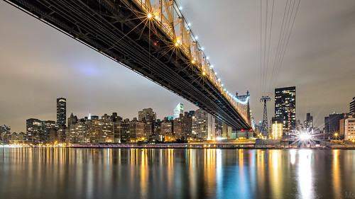 city nyc newyorkcity longexposure bridge light sky ny newyork reflection night skyscraper buildings river print island photography lights photo scenery gallery cityscape unitedstates image cloudy manhattan fineart stock scenic picture canvas eastriver flare nik suspensionbridge queensborobridge rooseveltisland starburst 59stbridge croporama mikeorso deffractionspikes