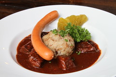 Vienna style beef goulash with sausages, pickles a…