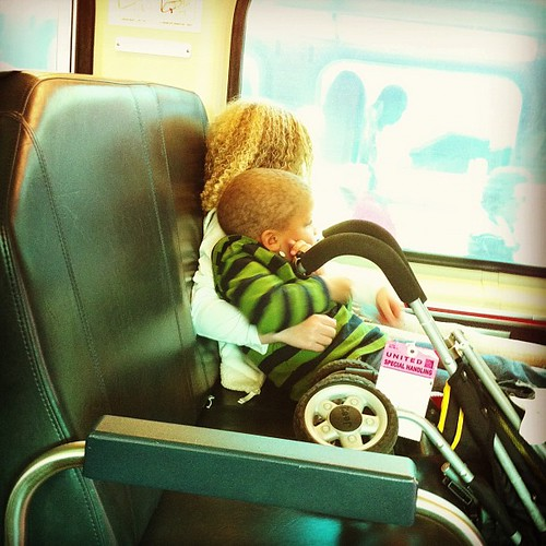 Snuggling and looking out the train window.  Awww.