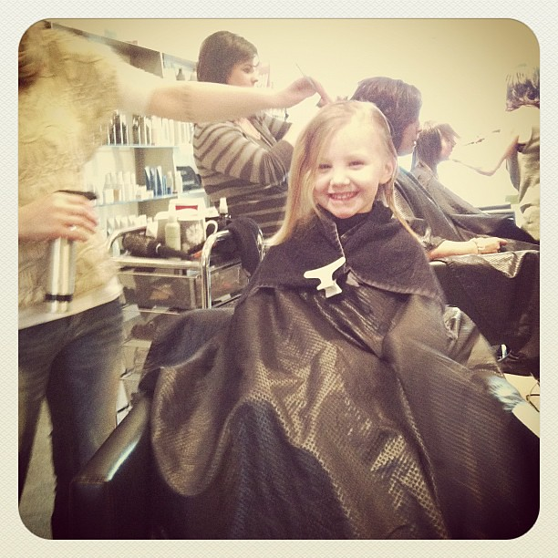 First hair cut at the salon. Someone's really excited!!