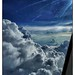 WeGoTwo posted a photo:	Our flight down from Hong Kong was short however the cloudscapes were beautiful.  The sun was also in the perfect spot in the sky.