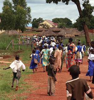 Ugandan children head to school.