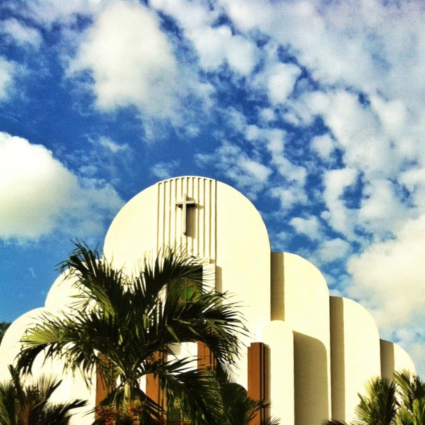 Unique building against pretty sky!
