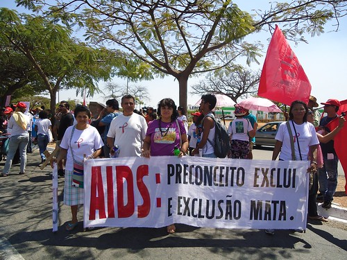 "AAVE & Aids Pastoral members take part in a local Independence Day Parade. The caption on the banner says ""AIDS: Prejudice excludes and exclusion kills"""