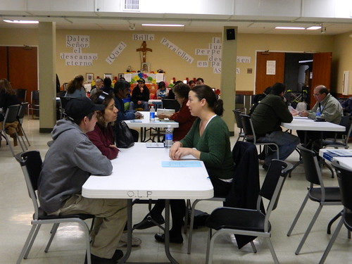 Legal volunteer meets with participants.