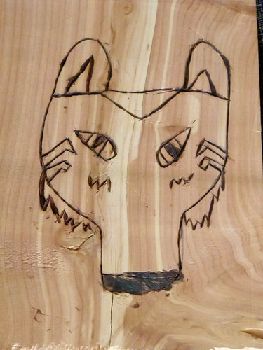 S's wood burned wolf