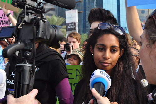 Campaigner from Arab Youth Movement being interviewed at Qatar's first ever rally against climate change