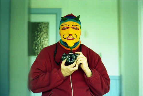reflected self-portrait with Minolta X-700 camera and jaundice by pho-Tony