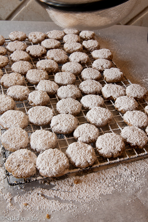 first coat of powdered sugar over cookies after cookies have been flipped.