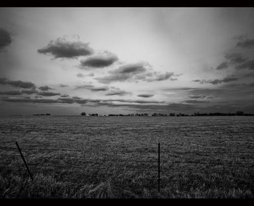 sky blackandwhite bw clouds rural fence texas olympus pasture huntcounty campbelltx huntcountytx gtowneric e620 ericwhodel