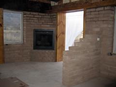 masonry oven(0.0), log cabin(0.0), floor(1.0), wall(1.0), wood(1.0), room(1.0), property(1.0), fireplace(1.0), brick(1.0), flooring(1.0), brickwork(1.0), hearth(1.0),