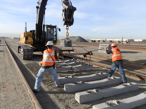 Photo of Workers Setting First Railroad Ties West of Havana Street
