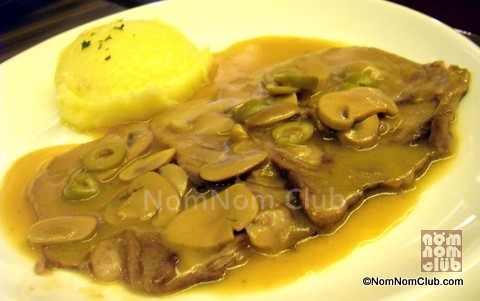 Lengua with mashed potatoes