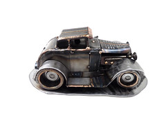 "'31 Ford ""Hand Surfing"" metal sculpture"