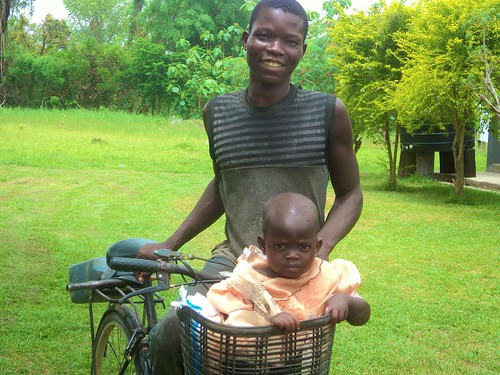 A father bringing his daughter to the Catholic Clinic Oku, Ghana