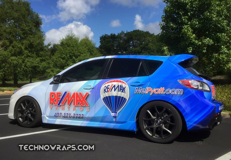 RE/MAX car wrap designed by TechnoSigns in Orlando