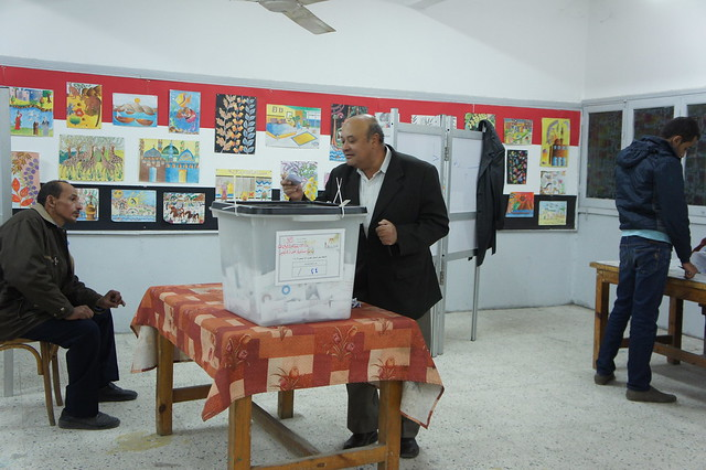 An Egyptian voter casting his vote at a polling station in Egypt's Giza