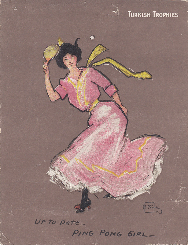 cigarette card in colour - woman in pink dress playing table-tennis. Card marked 'Turkish Trophies'