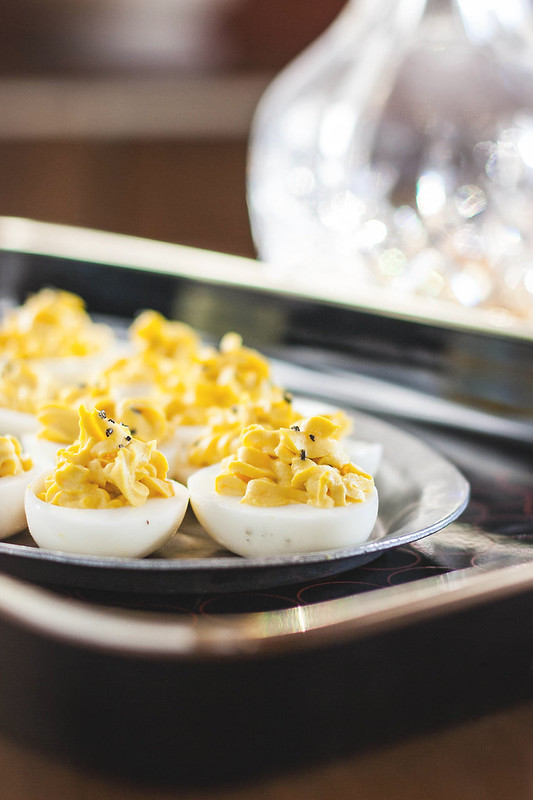 truffled deviled eggs with crème fraîche & black salt