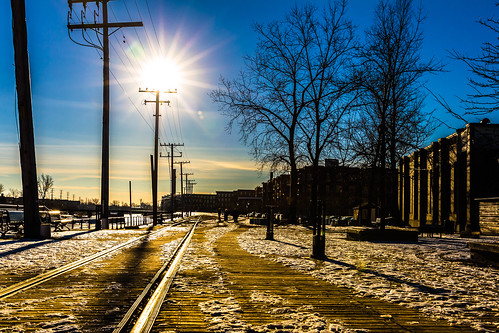 railroad blue winter sky sun snow canada building tree backlight train track power market quebec montreal pole atwater 7d electricity convergence atwatermarket lachinecanal 2470lii