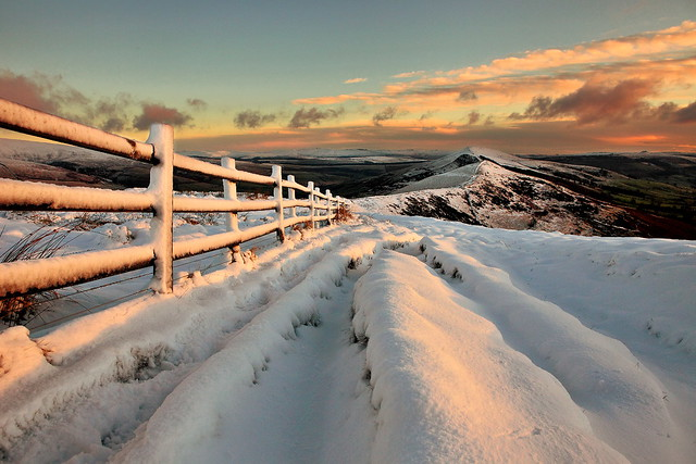 A Peak District sunrise with beautiful golden light on Mam Tor and the great ridge