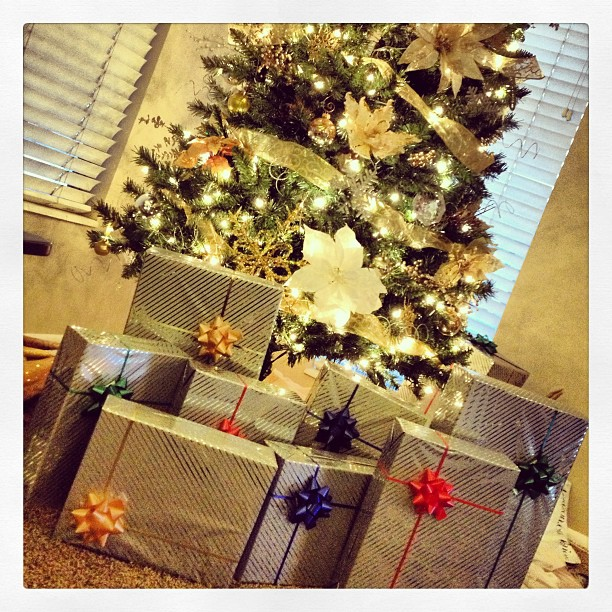 My brother sort of rules at wrapping presents. #gifts #tree #christmas #holiday #presents #instagood
