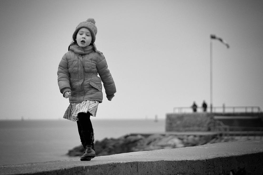 running and singing girl