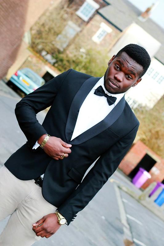 Men's black Tuxedo Jacket, white shirt, bow tie & beige skinny jeans: Street style