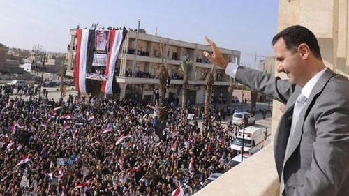 Syrian President Bashar al-Assad greets the people at mass rally. The imperialist war against Syria has lasted for nearly two years. by Pan-African News Wire File Photos