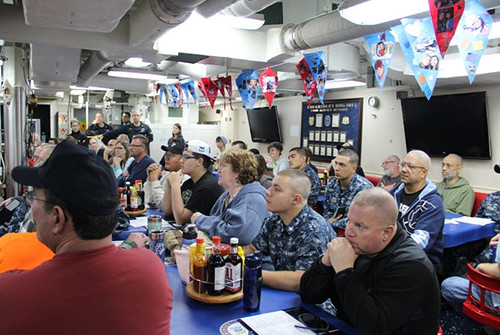 Family, friends and crewmember sponsors listen to the Tiger Cruise 2013 Welcome Aboard orientation