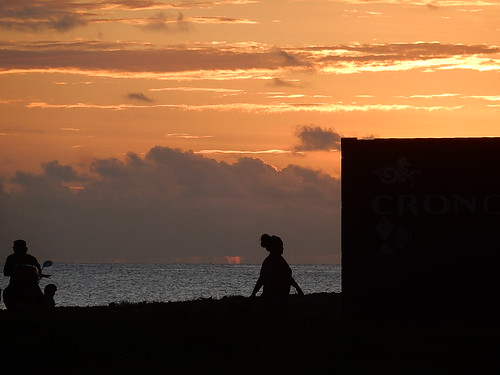 tuvalu funafuti container rightangle glow sunset silhouette shapes woman motorcyclist