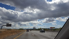 My bro is driving and I was able to relax and got this photo. Pretty clouds no?