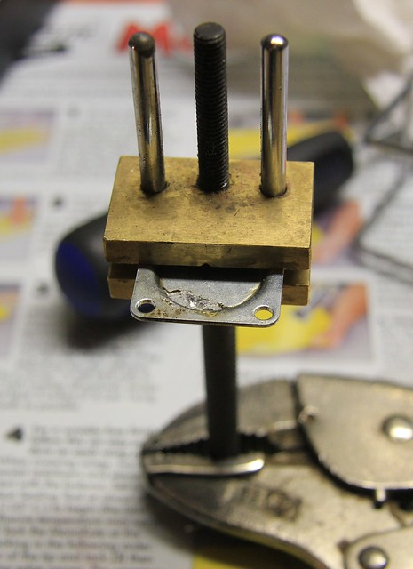 Diaphragm plate clamped for fill soldering