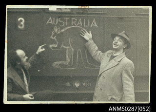 Migrants pointing to a painted kangaroo on a train, Ludwigsburg
