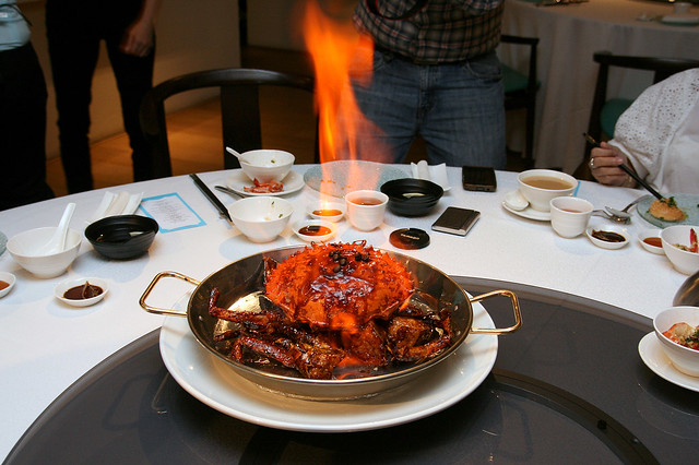 The Kopi Crab is flambed at your table