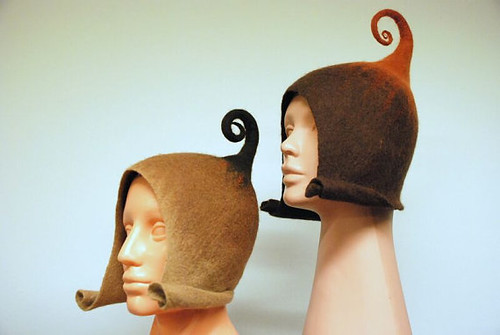 mannequin heads wearing felted gnomelike hats