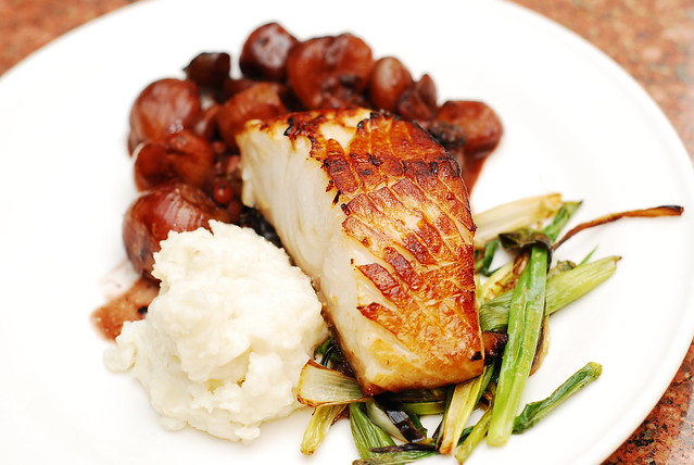 Black cod with balsamic and caramelized shallot sauce and mashed potatoes, roasted green onions, fish